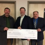 Left to right: Christopher J. Hopkins, MCI Headmaster, receives a $100,000 gift for the Founders Campaign from Stacey Fitts, the Master of Meridian Lodge #125 A.F.& A.M. (Ancient Free and Accepted Masons) and David Wright, President of the Trustees of the Meridian Lodge Charitable Fund, past Master and past District Deputy Grand Master of the 122nd Masonic District of the Grand Lodge of Maine. Fitts is a member of MCI's class of 1980. The photo was taken in the space their gift will name – the Choral and Piano Center in the Visual and Performing Arts Education Center in JR Cianchette Hall on MCI's campus.