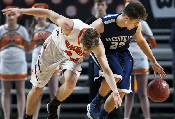 Machias' James Mersereau (left) battles for a loose ball with Greenville's Connor DiAngelo during their Class D boys basketball state championship at the Cross Insurance Center in Bangor Saturday.