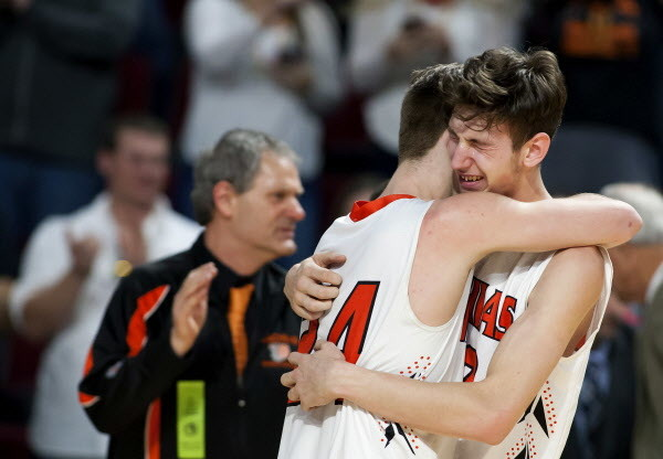 Machias' James Mersereau (left) embraces Machias' Mark Anthony after defeating Greenville during their Class D boys basketball state championship at the Cross Insurance Center in Bangor Saturday.