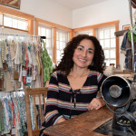Vero Poblete-Howell sits at an antique sewing machine in the Baobab Organics studio in Waldoboro on Feb. 10. Poblete-Howell, originally of Santiago, Chile, became a U.S. citizen Friday, March 3.