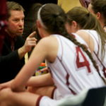 Bangor High School head coach Joe Johnson speaks to his players during a time out in the Eastern Maine girls basketball championship game in Augusta in 2015.