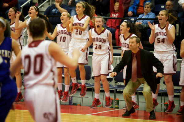 Bangor High School head coach Joe Johnson reacts with his players in the Eastern Maine girls basketball championship game in Augusta in 2015.
