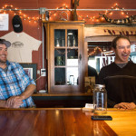 Knox County natives and childhood friends Scott Bendtson (left) and Ethan Evangelos stand behind the bar at their brewery and tap room, Thresher's Brewing Co., based in a converted lumber mill in Searsmont.