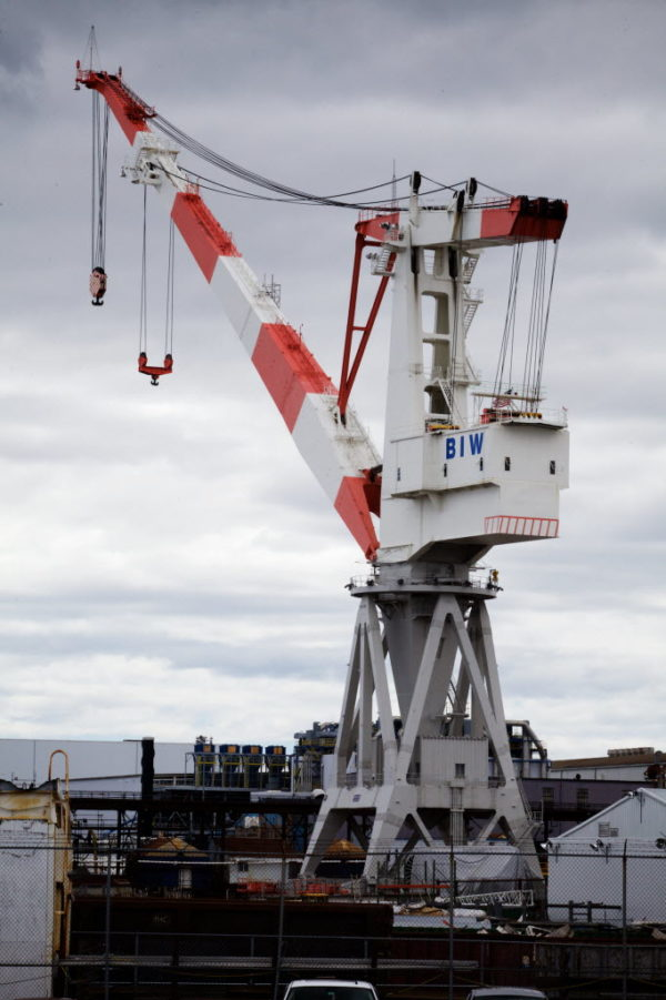 Bath Iron Works' largest crane towers over the shipyard in Bath in 2015.