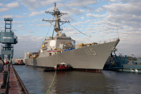 The future USS Rafael Peralta (DDG 115) is floated from the dock for the first time during its October 2015 christening at Bath Iron Works.