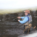Steve Mogul of Bangor casts a line in the St. George River in Searsmont recently.