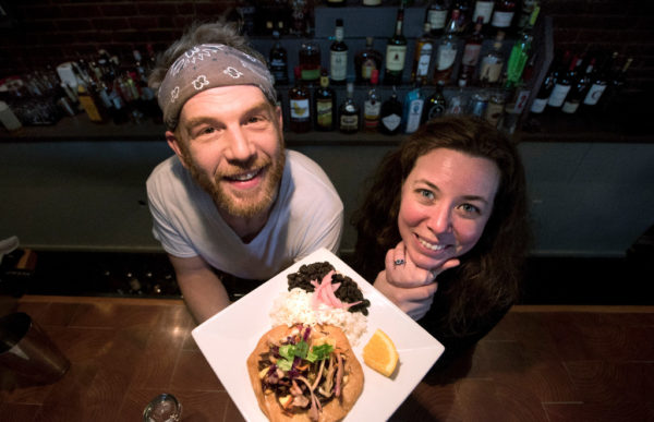 Seth Whited and Sarah Waldron with a Tostada dish at their new restaurant the Neighborhood in Belfast.