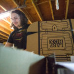 Bart Brizee, 25, of Bangor packs up shipments of his recently kickstarted subscription box service, LARP boxes, in the basement of his apartment on Thursday. A few years ago, Brizee started Eastern Front Designs, a company that creates costumes, prop weapons and other items for live action role players, or LARPers. Now he hopes to pack up similar gear and ship them to his customers' doorsteps once a month.