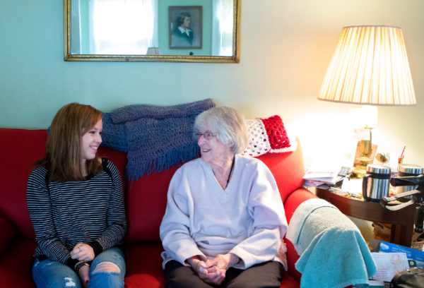 Emma Brickman (left) laughs with 92-year-old Joan Logue at Logue's home in Orono on Tuesday. Brickman visits with Logue one hour per week as part of Project Generations, a new program supported by the Eastern Area Agency on Aging and the Maine Center on Aging aimed at connecting student volunteers with senior citizens in the area, helping students appreciate the challenges of aging in place and giving seniors a lively young connection to the community.