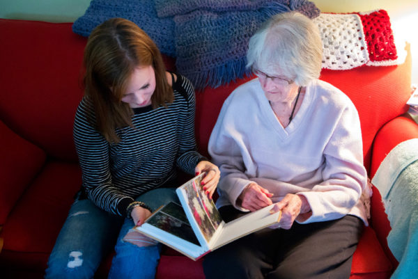 Emma Brickman (left) and 92-year-old Joan Logue look through a photo album at Logue's home in Orono on Tuesday. Brickman visits with Logue one hour per week as part of Project Generations, a new program supported by the Eastern Area Agency on Aging and the Maine Center on Aging aimed at connecting student volunteers with senior citizens in the area, helping students appreciate the challenges of aging in place and giving seniors a lively young connection to the community.