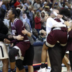 Mississippi State Lady Bulldogs head coach Vic Schaefer hugs guard Morgan William (2) in front of forward Breanna Richardson (3) after the game against the Connecticut Huskies in the semifinals of the women's Final Four at American Airlines Center. The Mississippi State Lady Bulldogs defeated the Connecticut Huskies in overtime 66-64.