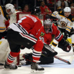 Chicago goalie Corey Crawford protects the net against Boston's Patrice Bergeron (37) in the second period of Sunday's NHL game at the United Center in Chicago.