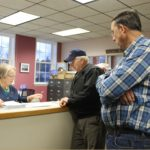 Caribou Secession Committee Spokesperson Paul Camping (center) and major petition circulator Milo Haney watch carefully as Caribou City Clerk Jayne Farrin reviews submitted petitions seeking secession submitted in March 2015.