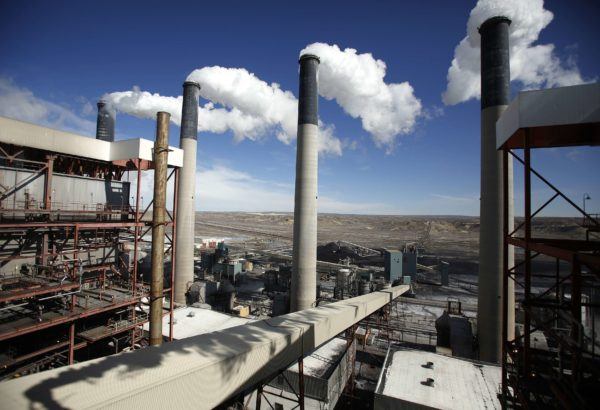 Steam rises from the stacks of the coal-fired Jim Bridger Power Plant outside Point of the Rocks, Wyoming in this file photo taken March 14, 2014. The U.S. power sector must cut carbon dioxide emissions 30 percent by 2030 from 2005 levels, according to federal regulations unveiled on Monday that form the centerpiece of the Obama administration's climate change strategy.  States which rely heavily on coal-fired power plants are thought to have the toughest tasks ahead.     REUTERS/Jim Urquhart/Files   (UNITED STATES - Tags: ENERGY BUSINESS POLITICS)
