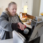 Rhonda Loignon makes a pot of coffee at her home in Rockland.