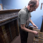 Dennis Watson, the owner of Burr Printing, demonstrates making a form of letters at his shop in downtown Bangor. Watson has been working at the shop since 1972. The original Thomas W. Burr Printing opened in 1879 in Bangor.