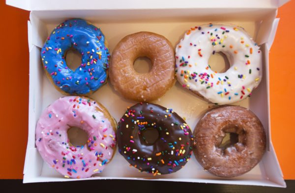 A box of donuts, (from top L clockwise) manager's special, traditional glazed, vanilla, pumpkin, chocolate and strawberry, is pictured at a newly opened Dunkin' Donuts store in Santa Monica, California September 2, 2014.