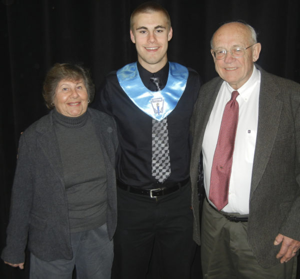 Former Ellsworth High School star and longtime high school coach Terry Spurling (right) poses with his wife Jane and grandson Kyle Bouchard in 2014. Spurling was a member of the first BDN All-Maine Schoolboy Basketball Team in 1956.