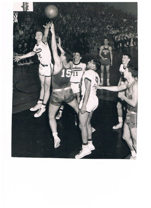 Former Old Town High School basketball star Don Sturgeon (left) blocks a shot during a game against John Bapst. Sturgeon was a member of the BDN's first All-Maine Schoolboy Basketball Team in 1956.