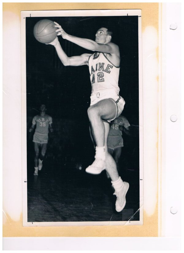 Former University of Maine basketball player Don Sturgeon of Old Town puts up a shot during a game against Rhode Island. Sturgeon was a member of the first BDN All-Maine Schoolboy Basketball Team in 1956.
