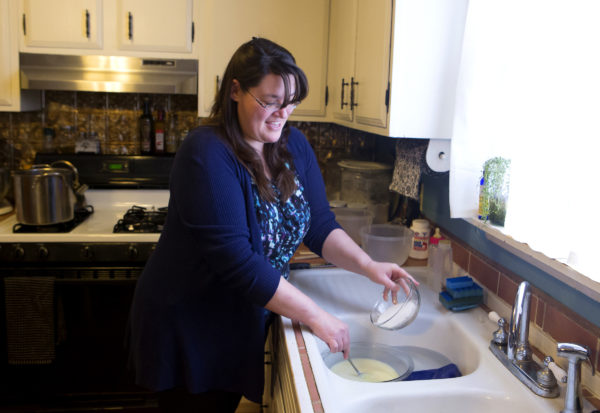 Sonja Twombly mixes lye with chilled goat milk to make soap at Lally Broch Farm in Frankfort.