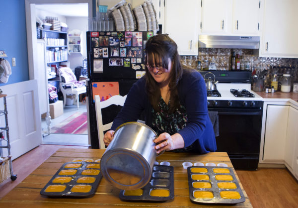Sonja Twombly pour her goat's milk soap mixture into moulds at Lally Broch Farm in Frankfort.