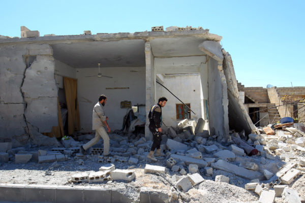 Civil defense members inspect the damage at a site hit by airstrikes on Tuesday, in the town of Khan Sheikhoun in rebel-held Idlib, Syria April 5, 2017.
