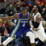 Atlanta's Paul Millsap (4) makes a move against Boston's Jae Crowder in the third quarter of Thursday's NBA game at Philips Arena in Atlanta. The Hawks won 123-116.