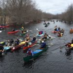Paddlers make their way downriver at the start of Saturday's Souadabscook Stream race in Hampden.