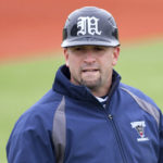 University of Maine interim head coach Nick Derba talks to the dugout during their baseball game against University of Hartford.