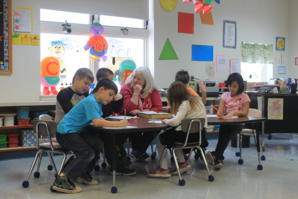 Washburn Elementary School teacher Kathy Adler leads an activity at the district's after-school program, March 7, 2017.