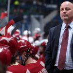 Jim Montgomery, pictured during a game on March 20, coached the University of Denver to the NCAA Division I hockey championship on Saturday. Montgomery, who played on the University of Maine's 1993 national title team, was in touch with former Black Bears assistant Grant Standbrook via text messages during the championship game.