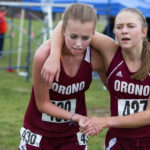 Orono High School teammates Kassidy Dill (left) and Hannah Steelman, pictured after competing in the Class C North cross-country championship at Belfast in October 2016, have both committed to Division I universities. Dill will attend North Carolina-Greensboro and Steelman is headed for Wofford in South Carolina.
