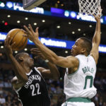 Brooklyn's Caris LeVert (left) is defended by Boston's Avery Bradley during the third quarter of Monday's NBA game at TD Garden in Boston. The Celtics won 114-105.