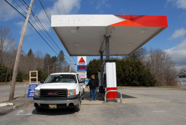 A motorist pumps gas at a Tradewinds Variety located on State Street in Veazie in a 2014 file photo.