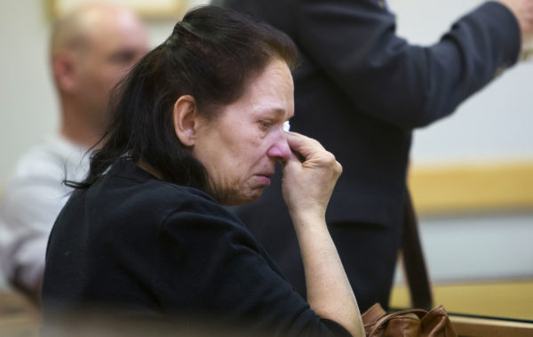 Linda Janeski of Winslow, who adopted Dakota three days before the kill order was issued, wipes a tear from her face after hearing that the motion to spare the life of Dakota the dog, who was pardoned by Gov. LePage, was denied in Waterville District Court.