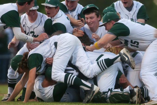 Old Town celebrates after defeating Hermon during their Class B North championship baseball game in June 2016 at Mansfield Stadium in Bangor.