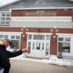 Bill Sutter, spokesman for the Wiscasset Taxpayers Alliance, points out a downtown building he said was once considered as a location for a parking lot in Wiscasset.
