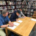 George Stevens Academy running star John  Hassett (center) signed a National Letter of Intent to run at the University of Maine on Wednesday. Flanking Hassett is his father, David, and GSA track and cross country coach Erich Reed.