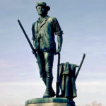 """The Minute Man"" statue by Daniel Chester French in Concord, Mass., which depicts Isaac Davis, a gunsmith and militia officer who commanded a company of Minutemen from Acton, Mass., during the first battle of the American Revolutionary War."