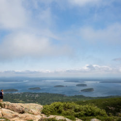 Tourists explore the Southwest side of Cadillac Mountain on a sunny summer day in July.