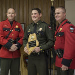 """The 2016 """"Warden of the Year"""" Kris MacCabe (center) accepts the coveted award on April 14, at the Maine Warden Service Annual Awards Banquet in Winslow."""