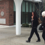 Orono resident Amy Hakola (left) leaves the Margaret Chase Smith Federal Building after being sentenced in U.S. District Court to a month in federal prison for allowing drug dealers from Connecticut to use her Charles Street home between 2010 and 2013.