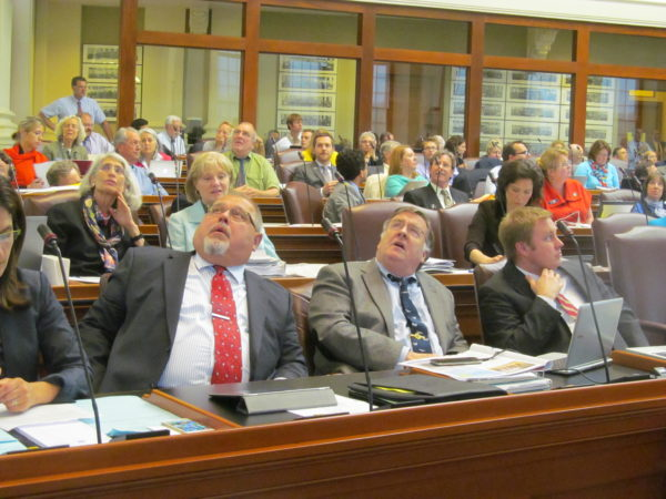 Democrats in the Maine House of Representatives watch votes tally on an amendment to the biennial state budget on June 16, 2015, at the State House in Augusta.