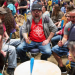 Larry Robichaud (center) participates in a drum circle with the Alamoosic Lake Signers during the 20th annual Wabanaki Spring Social at the Anah Shrine in Bangor Saturday.
