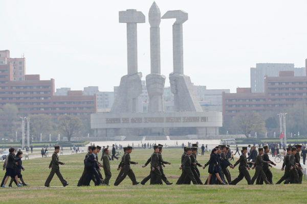 Soldiers walk in front of the Monument to the Foundation of the Workers' Party in Pyongyang, North Korea, April 16, 2017.