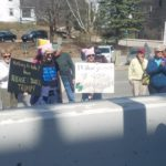 Between 80 and 100 protesters gathered in front of Margaret Chase Smith Federal Building on Tax Day Saturday to demand that President Donald Trump release his tax returns.