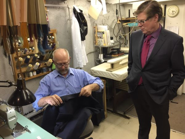 Joseph Redman (right) inspects the work of his full-time tailor Paul Loven in the basement of Joseph's.