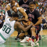 Chicago Bulls forward Cristiano Felicio (6) battles Boston Celtics forward Amir Johnson (90) and guard Avery Bradley (0) for a loose ball during the second quarter in game one of the first round of the 2017 NBA Playoffs on Sunday at TD Garden.