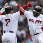 Boston Red Sox third baseman Pablo Sandoval (48) celebrates with catcher Christian Vazquez (7) after hitting a two-run homer during the fourth inning against the Tampa Bay Rays at Fenway Park on Sunday.